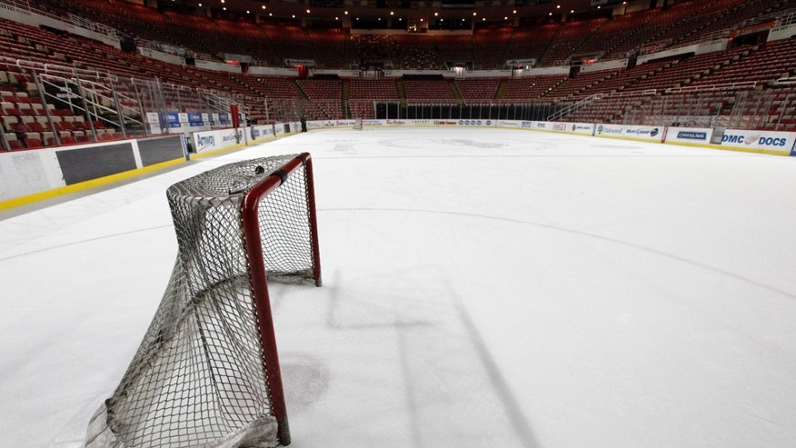 Dec. 18, 2012: A hockey goal sits on the ice at Joe Louis Arena home of the Detroit Red Wings hockey club in Detroit. The NHL lockout that's already wiped out the first three months of the season is taking its toll on small businesses in many of the NHL's markets.