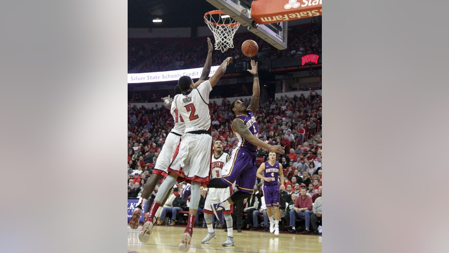 UNLV's Anthony Bennett, left, and Khem Biech (2) attempt to block Northern Iowa's Deon Mitchell who drives to the basket in the first half of an NCAA college basketball game on Wednesday, Dec. 19, 2012, in Las Vegas. (AP Photo/John Gurzinski)