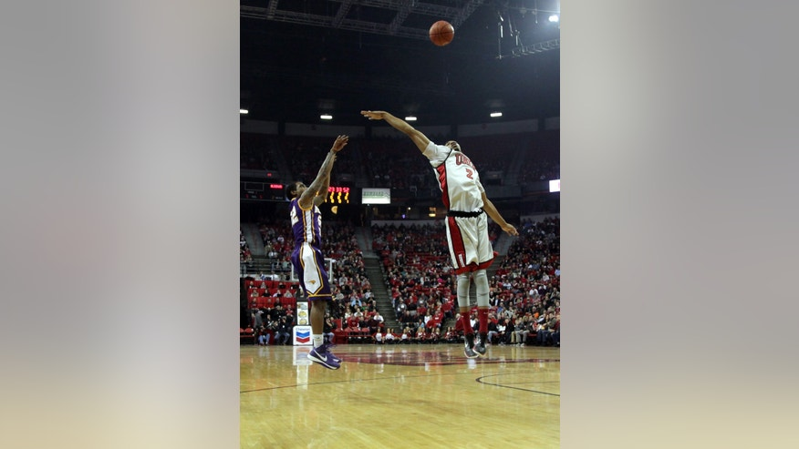 UNLV's Khem Birch, right, tries to block a shot from Northern Iowa's Marvin Singleton during the first half of an NCAA college basketball game on Wednesday, Dec. 19, 2012, in Las Vegas. (AP Photo/John Gurzinski)