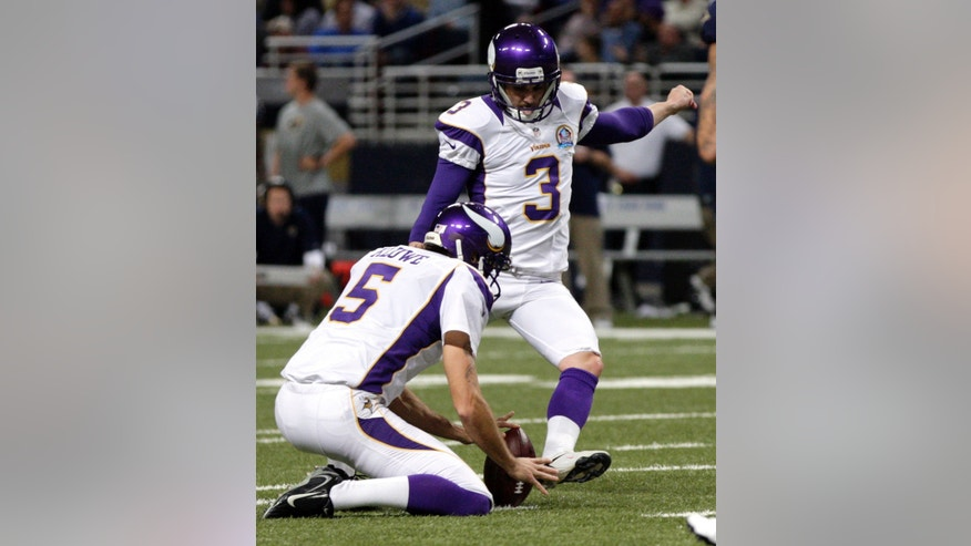 Minnesota Vikings kicker Blair Walsh (3) kicks a 38-yard field goal as Chris Kluwe holds during the second quarter of an NFL football game against the St. Louis Rams Sunday, Dec. 16, 2012, in St. Louis. (AP Photo/Tom Gannam)