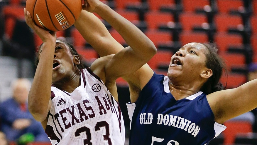 Texas A&M's Courtney Walker (33) is fouled by Old Dominion's Shakeva Richards during the first half of an NCAA college basketball game, Thursday, Dec. 20, 2012, in Las Vegas. (AP Photo/Julie Jacobson)