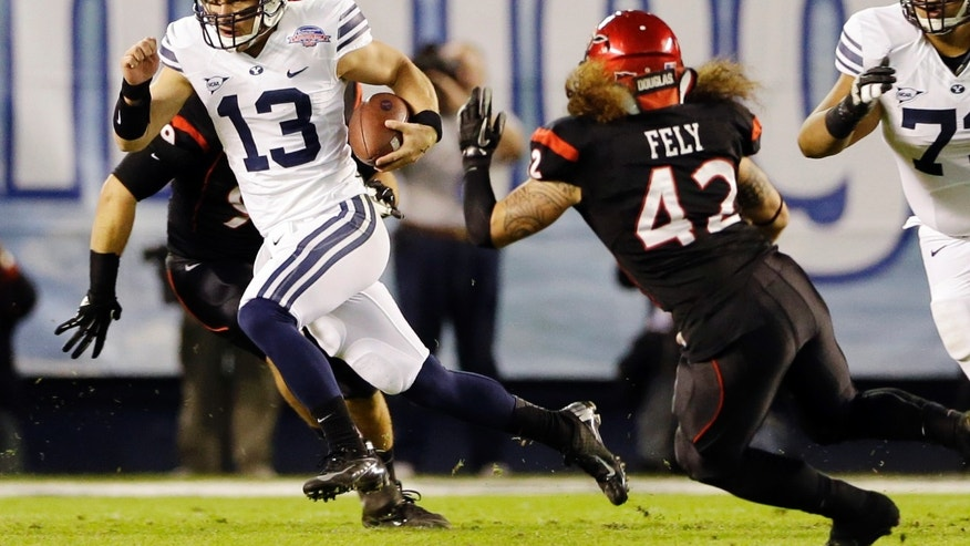 BYU quarterback Riley Nelson scrambles for a 13-yard gain and a first down against San Diego State during the first half of the Poinsettia Bowl NCAA college football game, Thursday, Dec. 20, 2012, in San Diego. (AP Photo/Lenny Ignelzi)