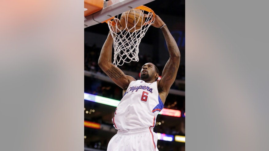 Los Angeles Clippers center DeAndre Jordan dunks against the New Orleans Hornets during the first half of an NBA basketball game in Los Angeles, Wednesday, Dec. 19, 2012. (AP Photo/Chris Carlson)