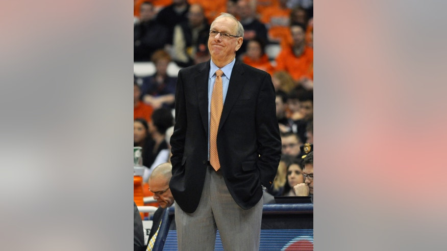 Syracuse coach Jim Boeheim watches during the first half of an NCAA college basketball game against Detroit in Syracuse, N.Y., Monday, Dec. 17, 2012. (AP Photo/Kevin Rivoli)