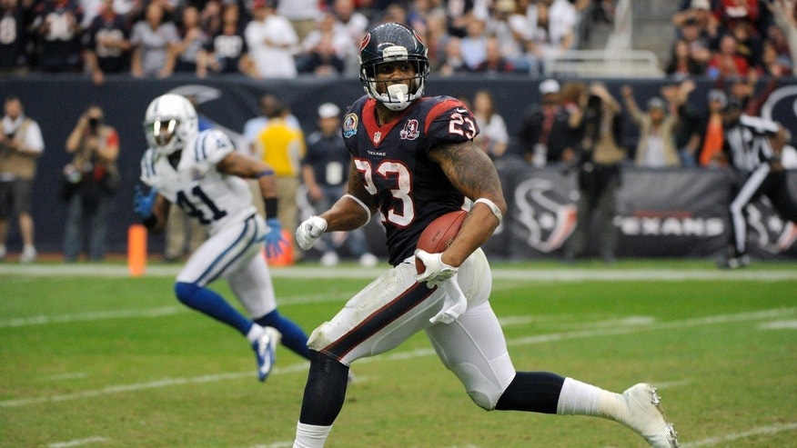 Houston Texans running back Arian Foster (23) rushes for a touchdown as Indianapolis Colts free safety Antoine Bethea (41) pursues in the fourth quarter of an NFL football game on Sunday, Dec. 16, 2012, in Houston. (AP Photo/Dave Einsel)