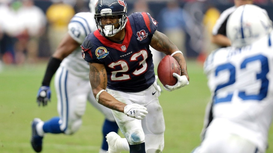 Houston Texans running back Arian Foster (23) rushes for a gain as Indianapolis Colts cornerback Vontae Davis, right, defends in the third quarter of an NFL football game on Sunday, Dec. 16, 2012, in Houston. (AP Photo/Eric Gay)