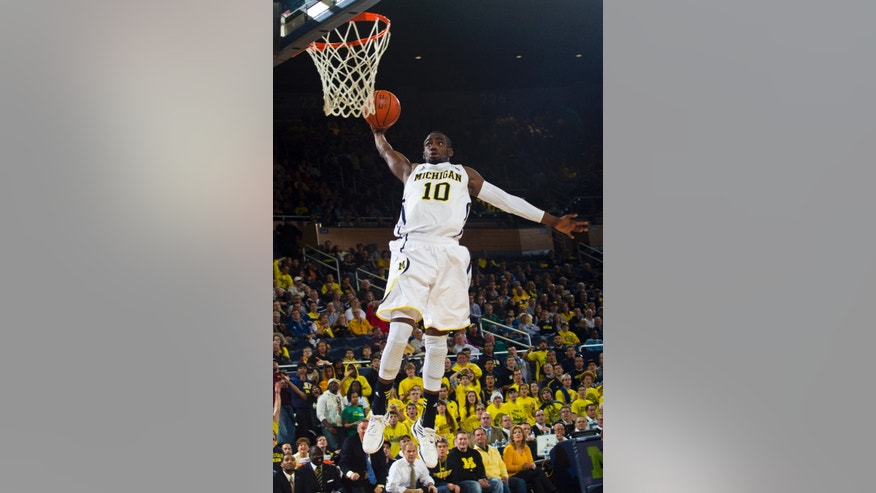 Michigan guard Tim Hardaway Jr. (10) makes a slam dunk in the second half of an NCAA college basketball game against Eastern Michigan, Thursday, Dec. 20, 2012, at Crisler Center in Ann Arbor, Mich. Michigan won 93-54. (AP Photo/Tony Ding)