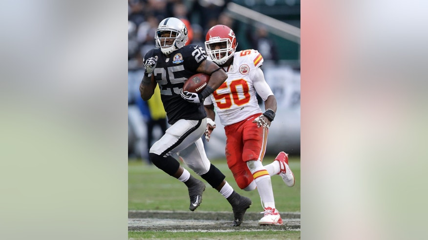 Oakland Raiders running back Mike Goodson (25) runs past Kansas City Chiefs outside linebacker Justin Houston (50) during the third quarter of an NFL football game in Oakland, Calif., Sunday, Dec. 16, 2012. (AP Photo/Marcio Jose Sanchez)