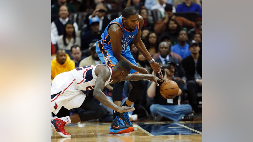 Atlanta Hawks shooting guard Anthony Morrow (22) and Oklahoma City Thunder small forward Kevin Durant (35) battle for a loose ball n the first half of an NBA basketball game on Wednesday, Dec. 19, 2012, in Atlanta. (AP Photo/John Bazemore)