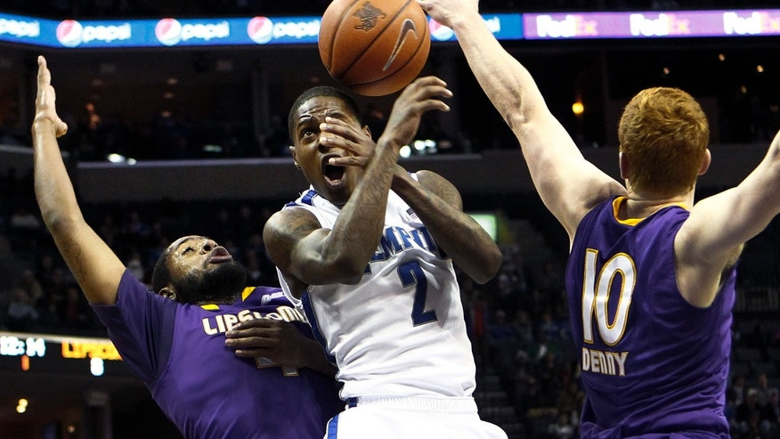 Memphis' Antonio Barton, center, loses control of the ball while driving to the basket by Lipscomb's Deonte Alexander, left, and Talbott Denny, right, during first-half NCAA college basketball game action in Memphis,Tenn., Thursday, Dec. 20, 2012. (AP Photo/The Commercial Appeal, Mark Weber)