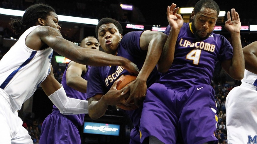 Memphis' Shaq Goodwin, left, battles Lipscomb's Stephen Hurt, center, and Deonte Alexander, right, for a rebound during first-half NCAA college basketball game action in Memphis,Tenn., Thursday, Dec. 20, 2012. (AP Photo/The Commercial Appeal, Mark Weber)