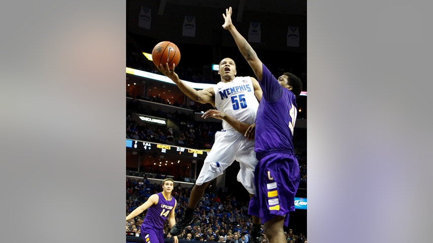 Memphis' Geron Johnson (55) drives to the basket by Lipscomb's Stephen Hurt, right, during first-half NCAA college basketball game action in Memphis,Tenn., Thursday, Dec. 20, 2012. (AP Photo/The Commercial Appeal, Mark Weber)