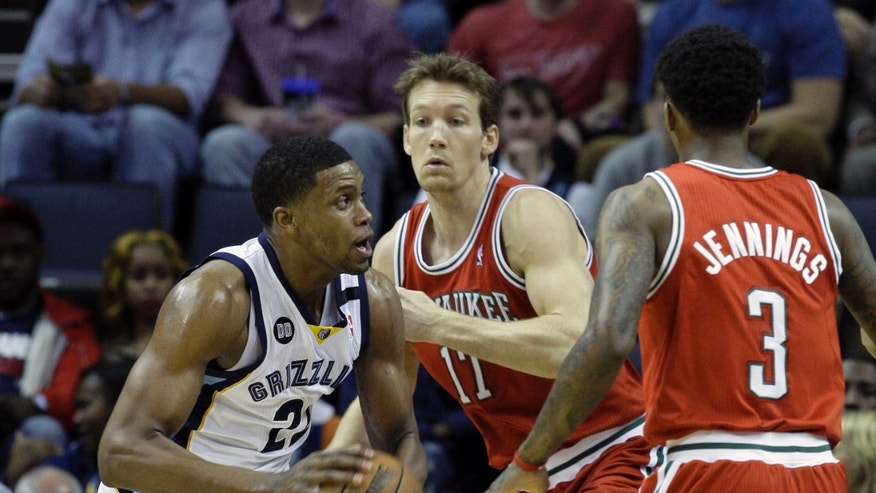 Memphis Grizzlies' Rudy Gay (22) is guarded by Milwaukee Bucks' Mike Dunleavy (17) and Brandon Jennings (3) during the first half of an NBA basketball game in Memphis, Tenn., Wednesday, Dec. 19, 2012. (AP Photo/Danny Johnston)