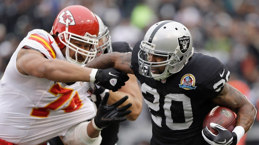 Oakland Raiders running back Darren McFadden (20) runs from Kansas City Chiefs defensive end Ropati Pitoitua (75) during the first quarter of an NFL football game in Oakland, Calif., Sunday, Dec. 16, 2012. (AP Photo/Jeff Chiu)