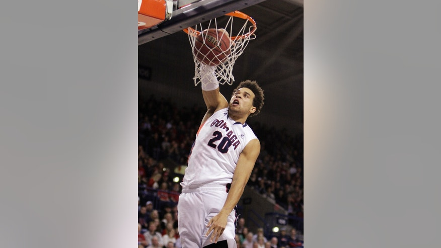 Gonzaga's Elias Harris dunks during the first half of an NCAA college basketball game against Campbell in Spokane, Wash., Wednesday, Dec. 19, 2012. (AP Photo/Young Kwak)