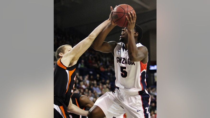 Gonzaga's Gary Bell Jr., (5) shoots a layup against Campbell's Andrew Ryan during the first half of an NCAA college basketball game in Spokane, Wash., Wednesday, Dec. 19, 2012. (AP Photo/Young Kwak)