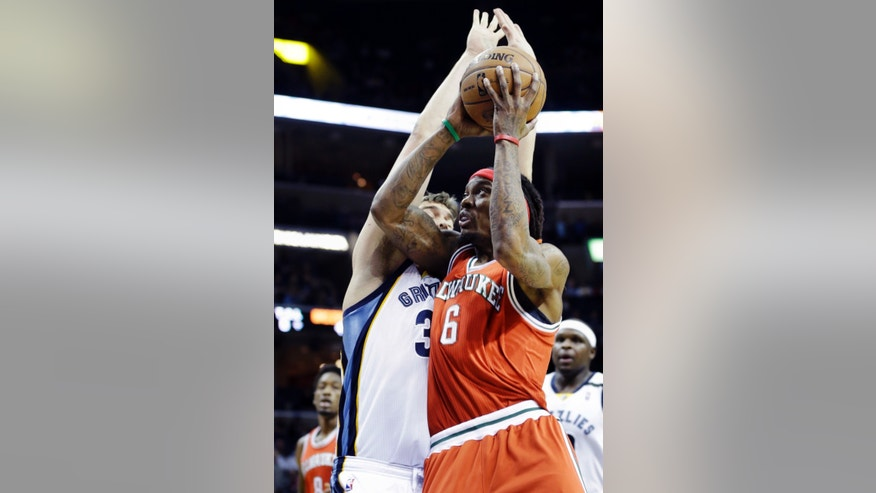 Milwaukee Bucks' Marquis Daniels (6) goes to the basket as he is pressured by Memphis Grizzlies' Marc Gasol, left, of Spain, during the first half of an NBA basketball game in Memphis, Tenn., Wednesday, Dec. 19, 2012. (AP Photo/Danny Johnston)