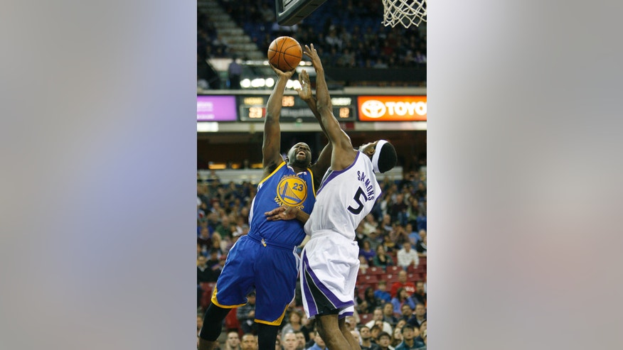 Golden State Warriors forward Draymond Green (23) drives to the basket against Sacramento Kings defender John Salmons during the first half of an NBA basketball game in Sacramento, Calif.,  Wednesday, Dec. 19, 2012.(AP Photo/Steve Yeater)