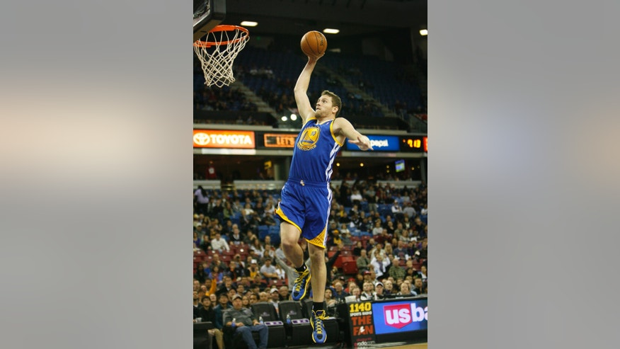 Golden State Warriors forward David Lee breaks away for a dunk against the Sacramento Kings during the first half of an NBA basketball game in Sacramento, Calif., Wednesday, Dec. 19, 2012.(AP Photo/Steve Yeater)