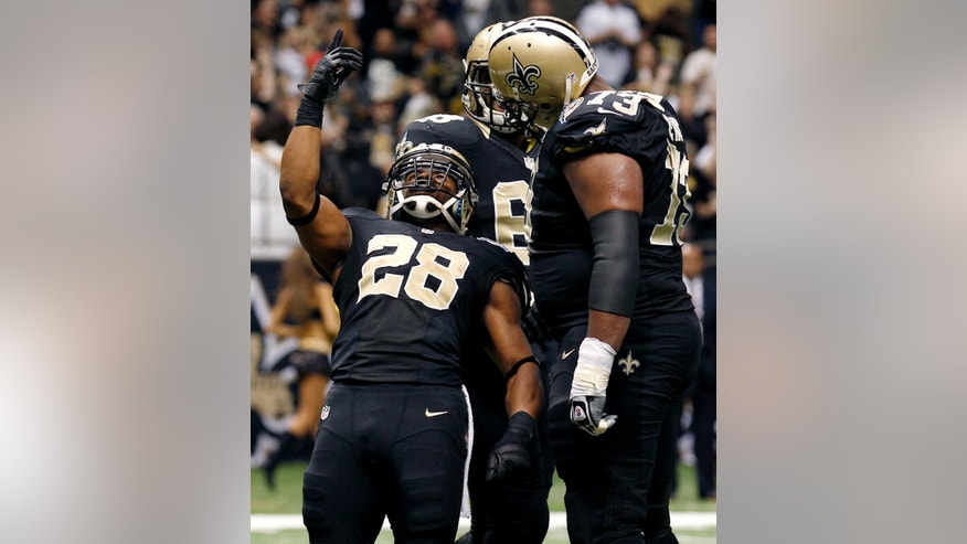 New Orleans Saints running back Mark Ingram (28) celebrates his touchdown with guard Jahri Evans (73) in the second half of an NFL football game against the Tampa Bay Buccaneers at Mercedes-Benz Superdome in New Orleans, Sunday, Dec. 16, 2012. The Saints won 41-0. (AP Photo/Bill Haber)