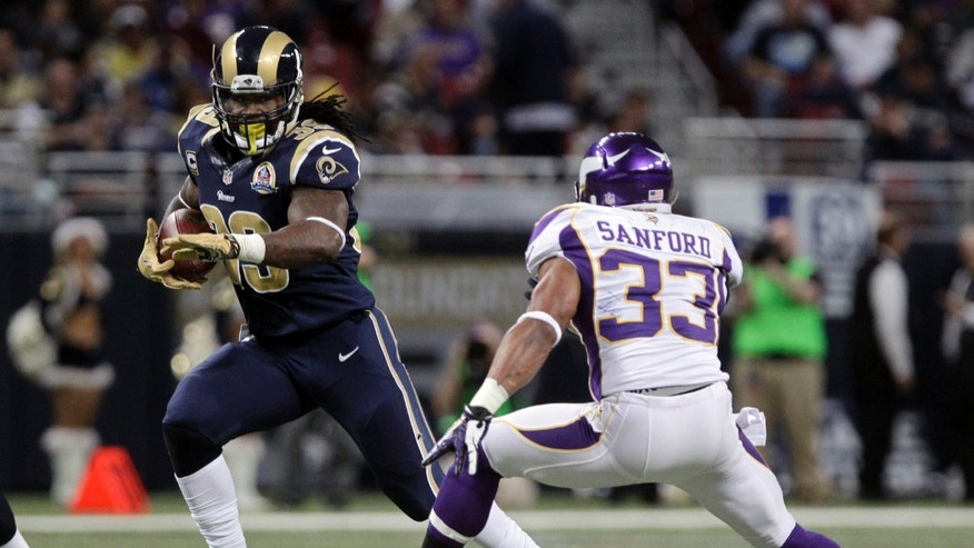 St. Louis Rams running back Steven Jackson, left, runs for an 8-yard gain as Minnesota Vikings strong safety Jamarca Sanford gives chase during the third quarter of an NFL football game Sunday, Dec. 16, 2012, in St. Louis. (AP Photo/Seth Perlman)