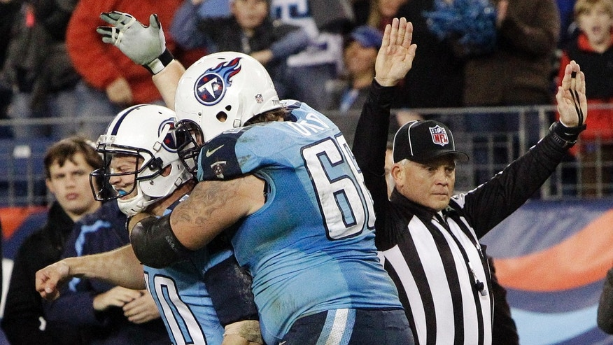 Tennessee Titans quarterback Jake Locker (10) is hugged by tackle Mike Otto (66) after running 13 yards for a touchdown against the New York Jets in the third quarter of an NFL football game, Monday, Dec. 17, 2012, in Nashville, Tenn. (AP Photo/Wade Payne)