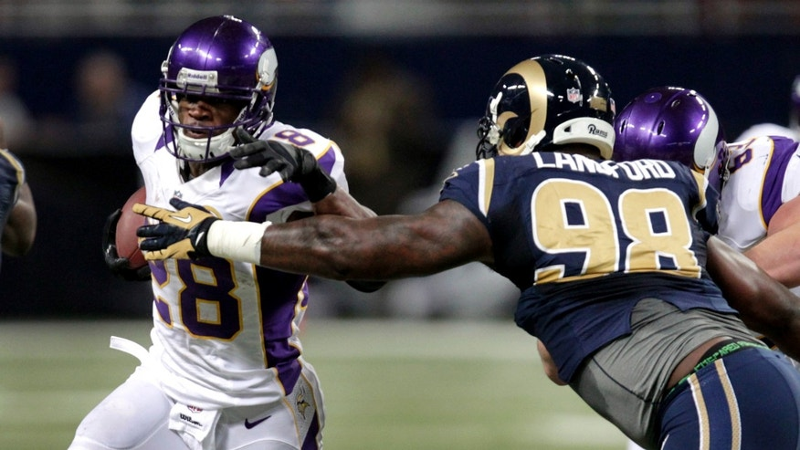 Minnesota Vikings running back Adrian Peterson, left, runs for a 13-yard gain as St. Louis Rams defensive tackle Kendall Langford defends during the second quarter of an NFL football game Sunday, Dec. 16, 2012, in St. Louis. (AP Photo/Tom Gannam)