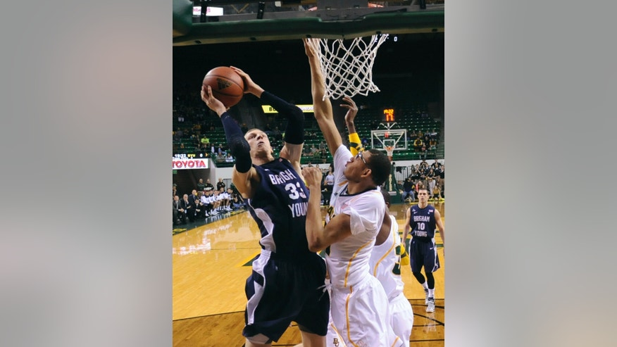 Brigham Young's Nate Austin, left, shoots over Baylor's Isaiah Austin during the first half of an NCAA college basketball game, Friday, Dec. 21, 2012, in Waco, Texas. (AP Photo/Waco Tribune Herald, Rod Aydelotte)