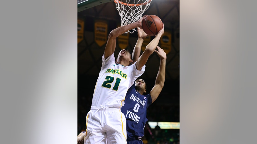 Baylor Isaiah Austin (21) shoots over Brigham Young's Brandon Davis, right, in the first half of an NCAA college basketball game, Friday, Dec. 21, 2012, in Waco, Texas. (AP Photo/Waco Tribune Herald, Rod Aydelotte)