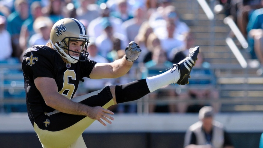 FILE- In this Oct. 2, 2011, file photo, New Orleans Saints punter Thomas Morstead follows through on a punt during an NFL football game against the Jacksonville Jaguars in Jacksonville, Fla. While the Saints have struggled,  Morstead has quietly had an extraordinary season. The former SMU standout is on pace to set an NFL record for net average in a season. (AP Photo/Phelan M. Ebenhack, File)