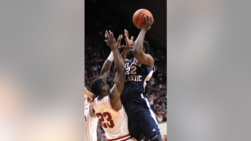 Florida Atlantic's Greg Gantt shoots over Indiana 's Remy Abell during the first half of an NCAA college basketball game in Bloomington, Ind., Friday, Dec. 21, 2012. (AP Photo Alan Petersime)