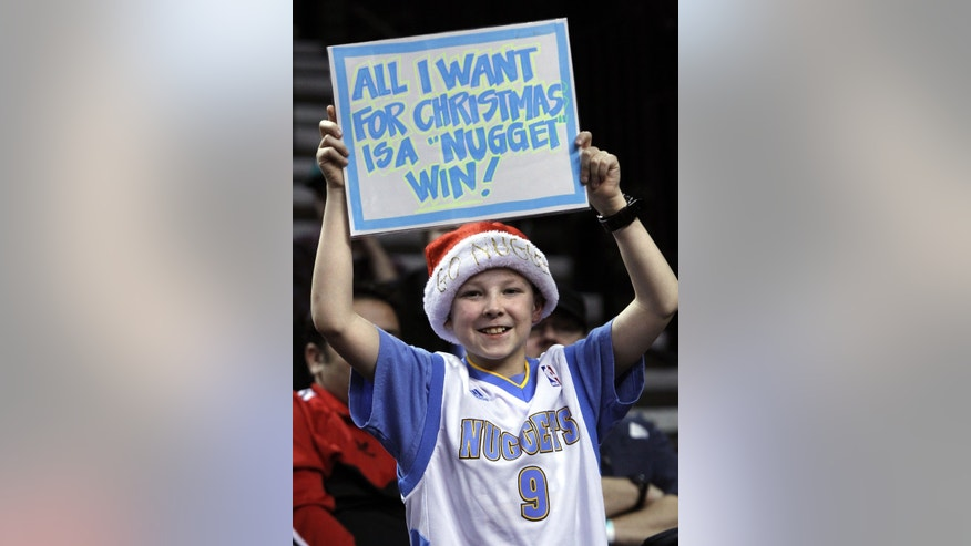 Denver Nuggets fan Braiden Espinosa holds up a sign during the first quarter of an NBA basketball game with the Portland Trail Blazers in Portland, Ore., Thursday, Dec. 20, 2012. (AP Photo/Don Ryan)