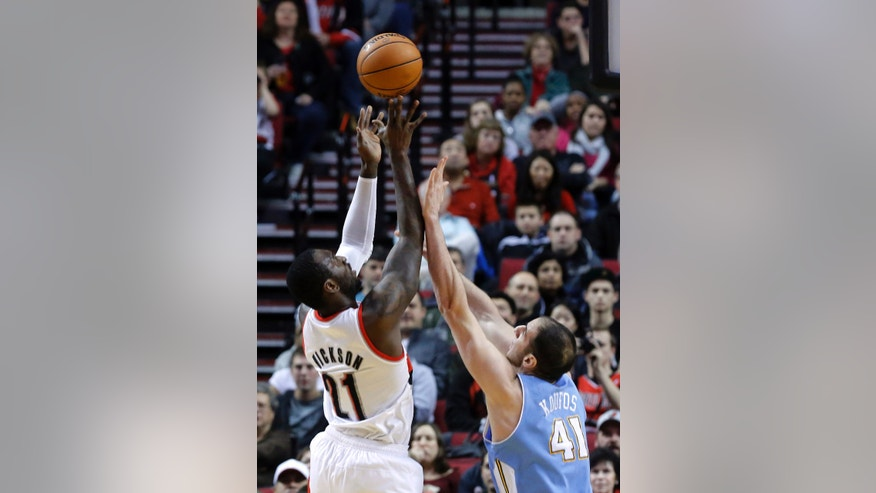 Portland Trail Blazers center J.J. Hickson, left, shoots over Denver Nuggets center Kosta Koufos during the first quarter of an NBA basketball game in Portland, Ore., Thursday, Dec. 20, 2012. (AP Photo/Don Ryan)