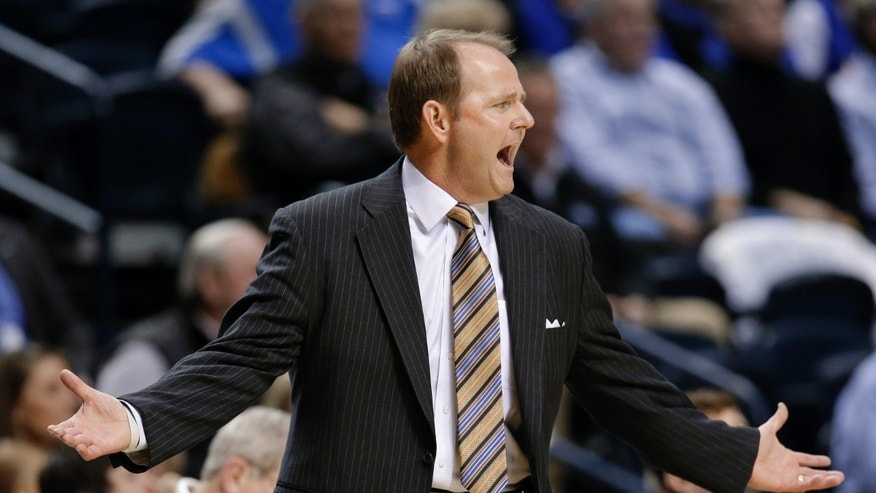 Middle Tennessee head coach Kermit Davis argues a call in the first half of an NCAA college basketball game against Vanderbilt, Friday, Dec. 21, 2012, in Nashville, Tenn. (AP Photo/Mark Humphrey)