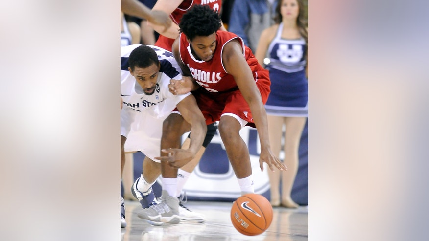 Utah State forward Kyisean Reed, left, and Nicholls State guard Amin Torres (5) scramble for a loose ball during their game in the World Vision Basketball Challenge, Thursday, Dec. 20, 2012, in Logan, Utah. (AP Photo/The Herald Journal, Eli Lucero)