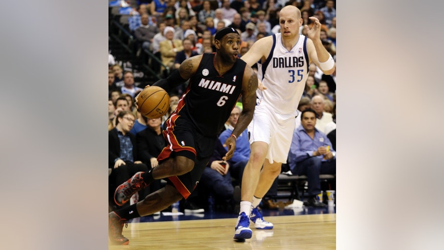 Miami Heat forward LeBron James (6) drives past Dallas Mavericks center Chris Kaman (35) during the first quarter of an NBA basketball game, Thursday, Dec. 20, 2012, Dallas. (AP Photo/LM Otero)