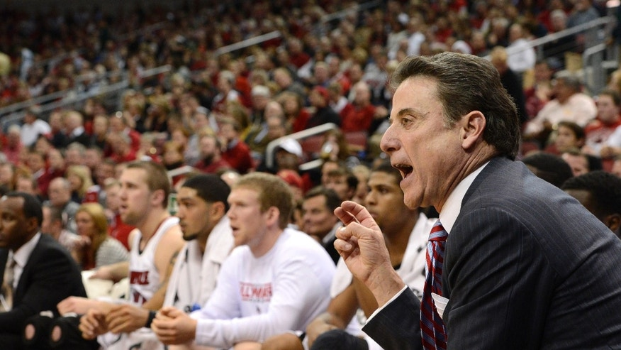 Louisville head coach Rick Pitino, right, shouts instructions to his team during the first half of an NCAA college basketball game against Florida on Wednesday, Dec. 19, 2012, in Louisville, Ky. (AP Photo/Timothy D. Easley)