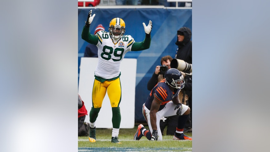 Green Bay Packers wide receiver James Jones (89) celebrates his touchdown reception in the first half of an NFL football game against the Chicago Bears in Chicago, Sunday, Dec. 16, 2012. At right is Bears cornerback Kelvin Hayden. (24)(AP Photo/Charles Rex Arbogast)