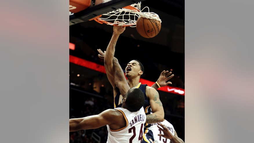 Indiana Pacers' Gerald Green, top, dunks the ball against Cleveland Cavaliers' Samardo Samuels during the fourth quarter of an NBA basketball game on Friday, Dec. 21, 2012, in Cleveland. The Pacers won 99-89. (AP Photo/Tony Dejak)