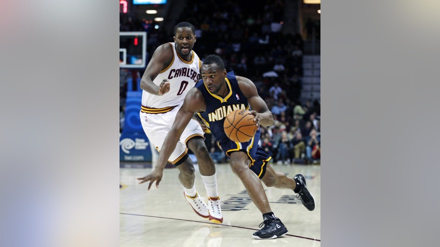 Indiana Pacers' Sam Young, right, drives past Cleveland Cavaliers' C.J. Miles (0) during the second quarter of an NBA basketball game on Friday, Dec. 21, 2012, in Cleveland. (AP Photo/Tony Dejak)