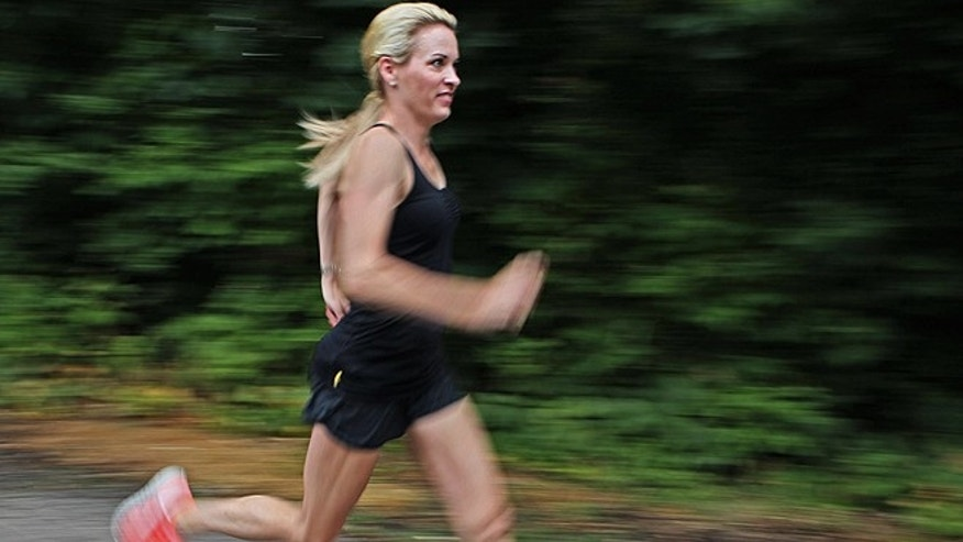 July 17, 2012: Suzy Favor Hamilton runs at her home in Shorewood Hills, a suburb of Madison, Wis. The three-time Olympian has admitted leading a double life as an escort. (AP Photo/Milwaukee Journal-Sentinel)