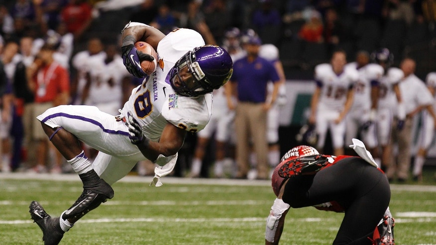 East Carolina running back Reggie Bullock (28) tumbles into the endzone on a touchdown run in the second half of the New Orleans Bowl, an NCAA college football game in New Orleans, Saturday, Dec. 22, 2012. Louisiana-Lafayette beat East Carolina 43-34. At right is Louisiana-Lafayette safety Rodney Gillis (21). (AP Photo/Bill Haber)