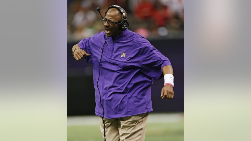 East Carolina head coach Ruffin McNeill reacts after a score by Louisiana Lafayette in the first half of the New Orleans Bowl, an NCAA college football game in New Orleans, Saturday, Dec. 22, 2012. (AP Photo/Dave Martin)