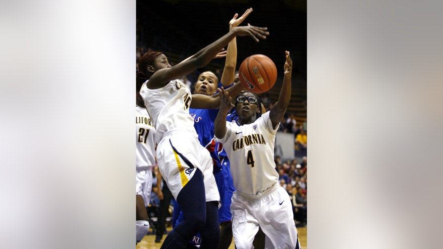 California's Gennifer Brandon, left, and Eliza Pierre, right, box in Kansas' Tania Jackson during the first  half of an NCAA women's college basketball game in Berkeley, Calif., Friday, Dec. 21, 2012. (AP Photo/Dino Vournas)