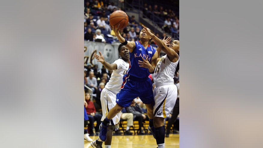 Kansas' Angel Goodrich, center, drives between California's Afure Jemerigbe, left, and Brittany Boyd in the first half of an NCAA women's college basketball game in Berkeley, Calif., Friday, Dec. 21, 2012. (AP Photo/Dino Vournas)