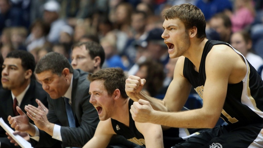 The Wofford bench reacts in the second half of an NCAA college basketball game against Xavier, Saturday, Dec. 22, 2012, in Cincinnati. Wofford won 56-55. (AP Photo/Tony Tribble)