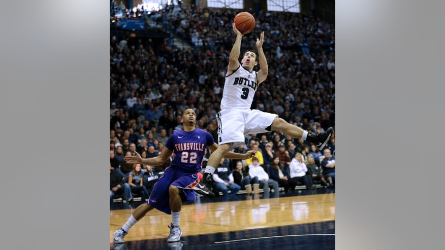 Butler guard Alex Barlow, right, shoots over Evansville guard Ned Cox during the first half of an NCAA college basketball game Saturday, Dec. 22, 2012 in Indianapolis. (AP Photo/AJ Mast)