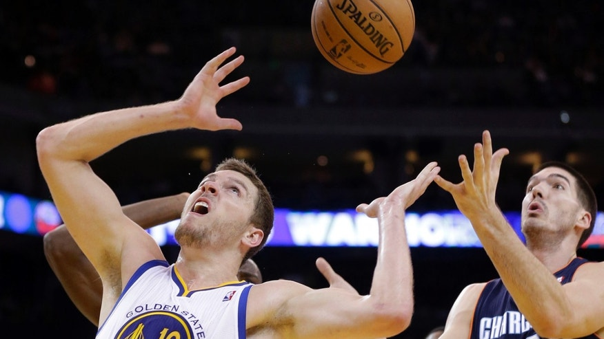 Golden State Warriors' David Lee (10) looks for a rebound next to Charlotte Bobcats' Byron Mullens (22) during the first half of an NBA basketball game in Oakland, Calif., Friday, Dec. 21, 2012. (AP Photo/Marcio Jose Sanchez)