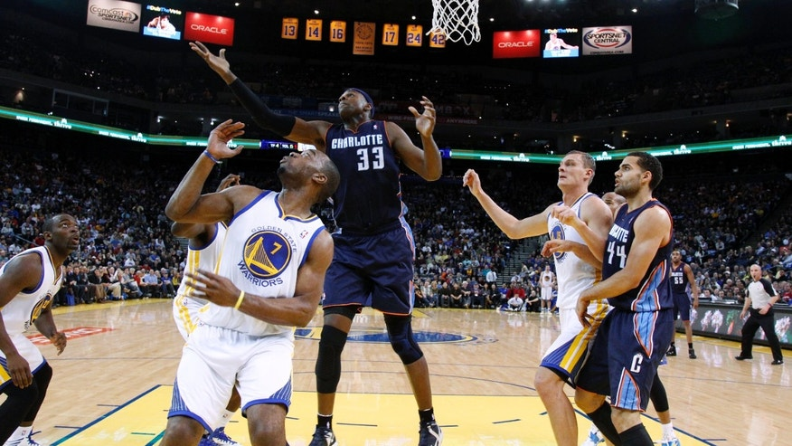 Charlotte Bobcats' Brendan Haywood (33) reaches for a rebound next to Golden State Warriors' Carl Landry (7) during the first half of an NBA basketball game in Oakland, Calif., Friday, Dec. 21, 2012. (AP Photo/Marcio Jose Sanchez)