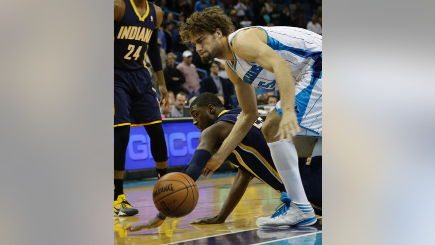 Indiana center Roy Hibbert (55) fights for a loose ball with New Orleans center Robin Lopez (15) in the first quarter of a NBA basketball game at the New Orleans Arena in New Orleans Saturday, Dec. 22, 2012. (AP Photo/Dave Martin)